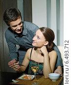 Купить «Young couple eating japanese food.», фото № 6493712, снято 29 февраля 2020 г. (c) BE&W Photo / Фотобанк Лори