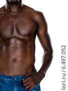 Купить «Close-up mid section of a shirtless muscular man», фото № 6497052, снято 2 апреля 2014 г. (c) Wavebreak Media / Фотобанк Лори
