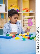 Купить «Cute little boy playing with building blocks», фото № 6501940, снято 15 мая 2014 г. (c) Wavebreak Media / Фотобанк Лори