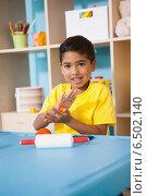Купить «Cute little boy playing with modelling clay in classroom», фото № 6502140, снято 15 мая 2014 г. (c) Wavebreak Media / Фотобанк Лори