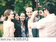 Купить «teenagers taking photo outside», фото № 6505012, снято 15 сентября 2013 г. (c) Syda Productions / Фотобанк Лори