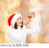 Купить «woman in santa helper hat with christmas ball», фото № 6505104, снято 15 августа 2013 г. (c) Syda Productions / Фотобанк Лори
