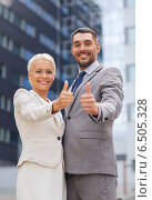 Купить «smiling businessmen showing thumbs up», фото № 6505328, снято 19 августа 2014 г. (c) Syda Productions / Фотобанк Лори