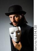 Купить «Funny concept with theatrical mask», фото № 6514120, снято 10 июля 2014 г. (c) Elnur / Фотобанк Лори