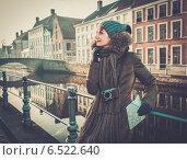 Купить «Woman tourist along canal in Bruges, Belgium», фото № 6522640, снято 30 ноября 2013 г. (c) Andrejs Pidjass / Фотобанк Лори