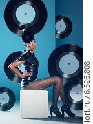 Купить «Disco woman on the chair with vinyl records», фото № 6526808, снято 19 февраля 2010 г. (c) Александр Буц / Фотобанк Лори