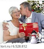 Купить «Senior man giving a kiss and a christmas present to his wife», фото № 6528812, снято 14 декабря 2019 г. (c) Wavebreak Media / Фотобанк Лори