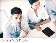 Купить «serious businessman on meeting in office», фото № 6531560, снято 9 июня 2013 г. (c) Syda Productions / Фотобанк Лори