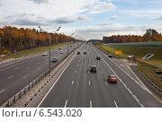 Купить «Автомобили на скоростном шоссе», фото № 6543020, снято 14 октября 2014 г. (c) Victoria Demidova / Фотобанк Лори