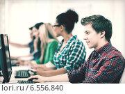 Купить «student with computer studying at school», фото № 6556840, снято 16 июня 2013 г. (c) Syda Productions / Фотобанк Лори