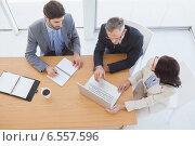 Купить «Business team taking down notes», фото № 6557596, снято 6 мая 2014 г. (c) Wavebreak Media / Фотобанк Лори