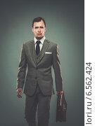 Купить «Well-dressed young businessman with a briefcase», фото № 6562424, снято 10 февраля 2012 г. (c) Andrejs Pidjass / Фотобанк Лори
