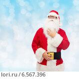Купить «man in costume of santa claus», фото № 6567396, снято 10 сентября 2014 г. (c) Syda Productions / Фотобанк Лори