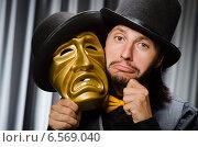 Купить «Funny concept with theatrical mask», фото № 6569040, снято 8 июля 2014 г. (c) Elnur / Фотобанк Лори