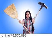 Купить «Young housewife doing housekeeping on white», фото № 6570896, снято 18 апреля 2013 г. (c) Elnur / Фотобанк Лори