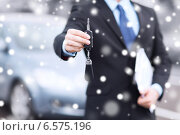 close up of man with car key outdoors. Стоковое фото, фотограф Syda Productions / Фотобанк Лори
