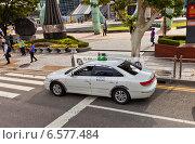 Купить «Белое такси на улице города Пусан, Южная Корея», фото № 6577484, снято 26 сентября 2014 г. (c) Иван Марчук / Фотобанк Лори