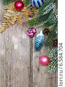 Купить «Новогодние украшения на деревянном фоне», фото № 6584704, снято 27 сентября 2014 г. (c) Елена Блохина / Фотобанк Лори