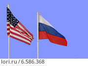 Купить «Государственные флаги России и США рядом на фоне синего неба», эксклюзивное фото № 6586368, снято 24 апреля 2014 г. (c) Щеголева Ольга / Фотобанк Лори