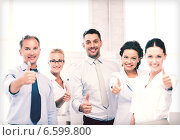 Купить «business team showing thumbs up in office», фото № 6599800, снято 9 июня 2013 г. (c) Syda Productions / Фотобанк Лори