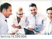 Купить «businesswoman with team on meeting in office», фото № 6599804, снято 9 июня 2013 г. (c) Syda Productions / Фотобанк Лори