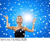 Купить «smiling woman raising hands and looking up», фото № 6602828, снято 1 июня 2014 г. (c) Syda Productions / Фотобанк Лори