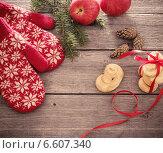 Купить «red mittens and christmas decoration on wooden background», фото № 6607340, снято 26 октября 2014 г. (c) Майя Крученкова / Фотобанк Лори