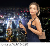 woman in evening dress with vip card. Стоковое фото, фотограф Syda Productions / Фотобанк Лори