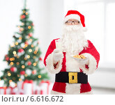 Купить «santa claus with glass of milk and cookies», фото № 6616672, снято 10 сентября 2014 г. (c) Syda Productions / Фотобанк Лори