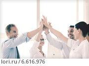 Купить «happy business team giving high five in office», фото № 6616976, снято 9 июня 2013 г. (c) Syda Productions / Фотобанк Лори