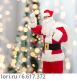 Купить «man in costume of santa claus with bag», фото № 6617372, снято 10 сентября 2014 г. (c) Syda Productions / Фотобанк Лори