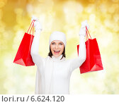 Купить «smiling young woman with red shopping bags», фото № 6624120, снято 15 августа 2013 г. (c) Syda Productions / Фотобанк Лори