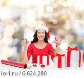Купить «smiling woman in santa helper hat packing gifts», фото № 6624280, снято 20 октября 2013 г. (c) Syda Productions / Фотобанк Лори