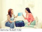 Купить «two smiling teenage girls with plane tickets», фото № 6627132, снято 12 апреля 2014 г. (c) Syda Productions / Фотобанк Лори