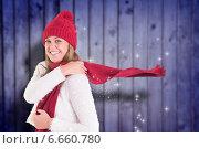 Composite image of happy blonde in winter clothes. Стоковое фото, агентство Wavebreak Media / Фотобанк Лори