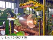 Намоточный станок для намотки в рулон оцинкованной стали на заводе. Стоковое фото, фотограф Iordache Carmen Anne Marie / Фотобанк Лори