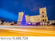 Купить «Baku - JANUARY 3, 2014: Government House on January 3 in Azerbaijan, Baku. Christmas Tree in front of the Government House», фото № 6686724, снято 3 января 2014 г. (c) Elnur / Фотобанк Лори