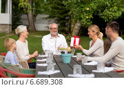 Купить «happy family having holiday dinner outdoors», фото № 6689308, снято 21 августа 2014 г. (c) Syda Productions / Фотобанк Лори