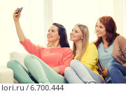 Купить «teenage girls taking selfie with smartphone», фото № 6700444, снято 12 апреля 2014 г. (c) Syda Productions / Фотобанк Лори