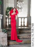 Купить «Красивая девушка в красном платье в интерьере старого замка», фото № 6708748, снято 8 ноября 2014 г. (c) Pukhov K / Фотобанк Лори