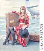 Купить «Красивая девушка с большими чемоданами на летном поле аэродрома», фото № 6727332, снято 21 апреля 2019 г. (c) Виктор Застольский / Фотобанк Лори