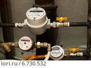 Купить «Два газовых счетчика и счетчик воды», эксклюзивное фото № 6730532, снято 29 ноября 2014 г. (c) Юлия Бабкина / Фотобанк Лори