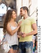 Couple with smartphone at street. Стоковое фото, фотограф Яков Филимонов / Фотобанк Лори