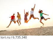 Купить «smiling friends dancing and jumping on beach», фото № 6735340, снято 3 августа 2014 г. (c) Syda Productions / Фотобанк Лори