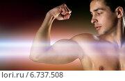 Купить «close up of young man flexing and showing biceps», фото № 6737508, снято 22 сентября 2014 г. (c) Syda Productions / Фотобанк Лори
