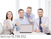 Купить «business team working with laptop in office», фото № 6739312, снято 5 апреля 2014 г. (c) Syda Productions / Фотобанк Лори