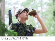 Купить «young soldier with gun and flask in forest», фото № 6741016, снято 14 августа 2014 г. (c) Syda Productions / Фотобанк Лори