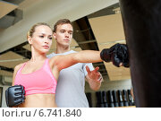 Купить «woman with personal trainer boxing in gym», фото № 6741840, снято 29 июня 2014 г. (c) Syda Productions / Фотобанк Лори