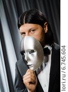 Купить «Funny concept with theatrical mask», фото № 6745604, снято 1 июля 2014 г. (c) Elnur / Фотобанк Лори