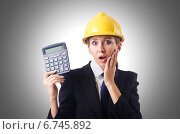 Купить «Female construction worker with calculator», фото № 6745892, снято 26 июля 2012 г. (c) Elnur / Фотобанк Лори